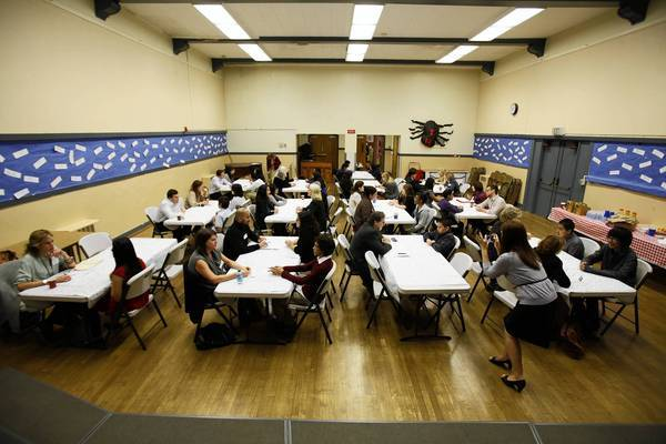 Eighth-grade students from Gabriella Charter School practice interviews in the auditorium of Logan Street Elementary School. The two schools share the campus.