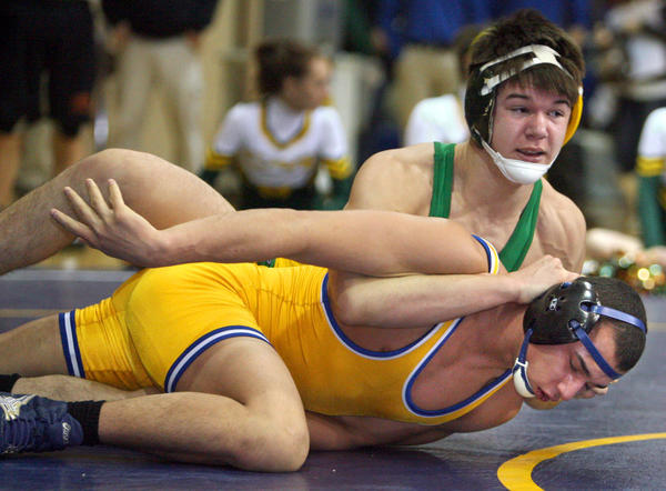 Aberdeen Roncalli's Tyson Mitzel ties up Aberdeen Central's Alex Ruelas during a semifinal match at the Lee Wolf Tournament last season.