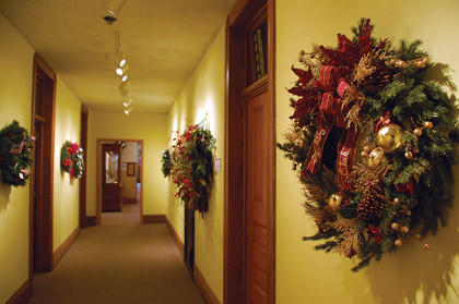 Decorated wreaths hang in a hallway on the second floor of the Dacotah Prairie Museum. American News Photo by Calvin Men