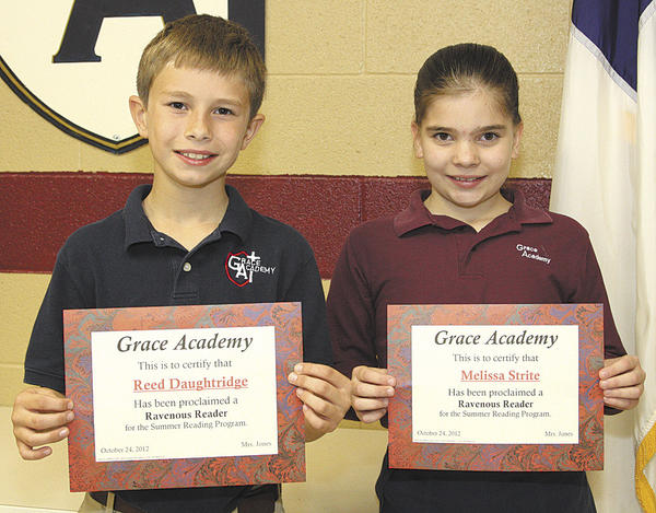 Reed Daughtridge, a fifth-grader, and Melissa Strite, a fourth-grader, were named top readers in the summer reading program at Grace Academy