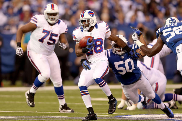 C.J. Spiller #28 of the Buffalo Bills is brought down from behind by Jerrell Freeman #50 of the Indianapolis Colts at Lucas Oil Stadium on November 25, 2012 in Indianapolis, Indiana. Indianapolis won 20–13.