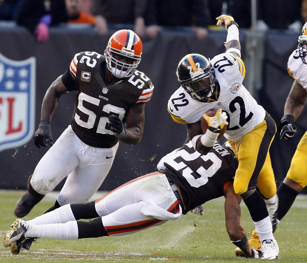 Running back Chris Rainey #22 of the Pittsburgh Steelers is hit by defenders Joe Haden #23 and D'Qwell Jackson #52 of the Cleveland Browns at Cleveland Browns Stadium on November 25, 2012 in Cleveland, Ohio. Cleveland won 20–14.