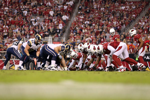 The Arizona Cardinals and the St. Louis Rams line up for during the NFL game at the University of Phoenix Stadium on November 25, 2012 in Glendale, Arizona. The Rams defeated the Carindals 31–17.