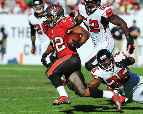 Running back Doug Martin #22 of the Tampa Bay Buccaneers rushes upfield against the Atlanta Falcons November 25, 2012 at Raymond James Stadium in Tampa, Florida. The Falcons won 24–23.