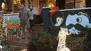 Even before the lights began blinking Saturday night on West 34th Street in Hampden, there was a clear audience favorite among this year's over-the-top neighborhood Christmas display.