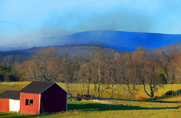 The fire in the Indian Springs Wildlife Management Area on Sunday afternoon, as seen from Funkhouser Road near Clear Spring.