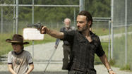 "With one week to go until the midseason finale, ""The Walking Dead"" seems to be seeding the ground with gunpowder in anticipation. The impact of this episode comes less from violence than the threat of violence, which, as we see several times, can be just as effective as the real thing. Fear isn't pain, after all -- it's the anticipation of pain, an imagining of what might happen. The best way to make people do what you want isn't necessarily to do something bad to them; it's to make them think that you will."