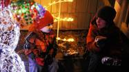Cold doesn't deter crowds from welcoming Santa to Arbutus