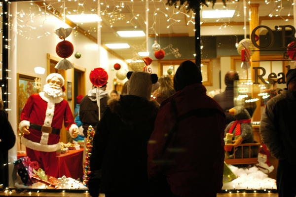 A couple stops to look at a window display during the Boyne City Holiday Open House Friday evening.
