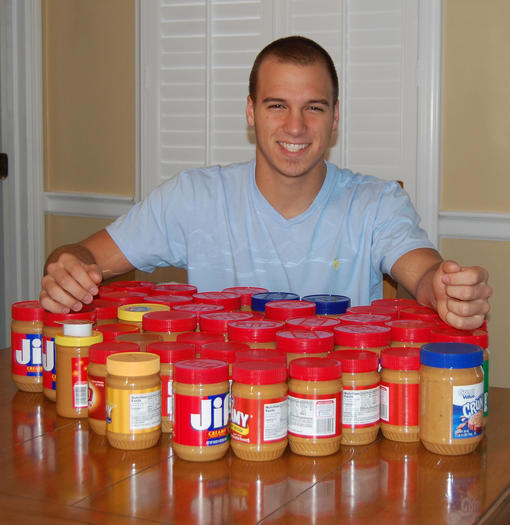 Harrodsburg teen Mac Guay collects peanut butter, which he donates to families in need in Mercer County.