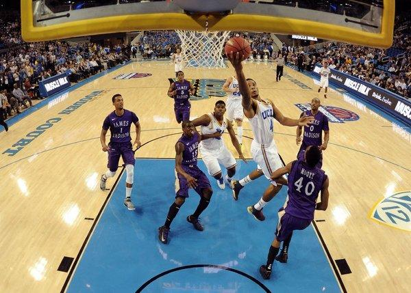 Norman Powell of UCLA scores on a layup during a 100-70 victory over James Madison on Nov. 15.