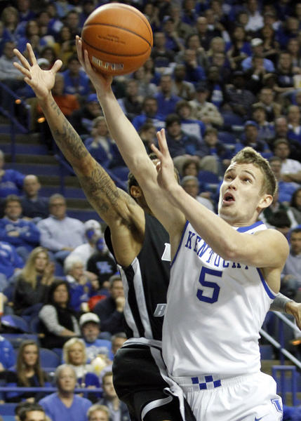Kentucky's Jarrod Polson (5) shoots under pressure from LIU Brooklyn's C.J. Garner, left, during the first half at Rupp Arena Friday.