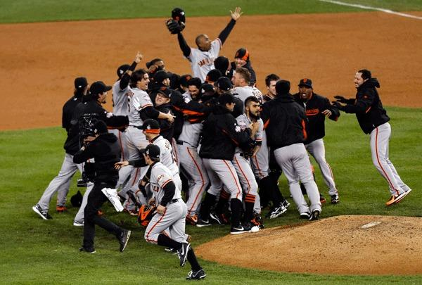 The San Francisco Giants celebrate defeating the Detroit Tigers to in the World Series in game four of the 2012 World Series at Comerica Park. The Giants won 4-3.