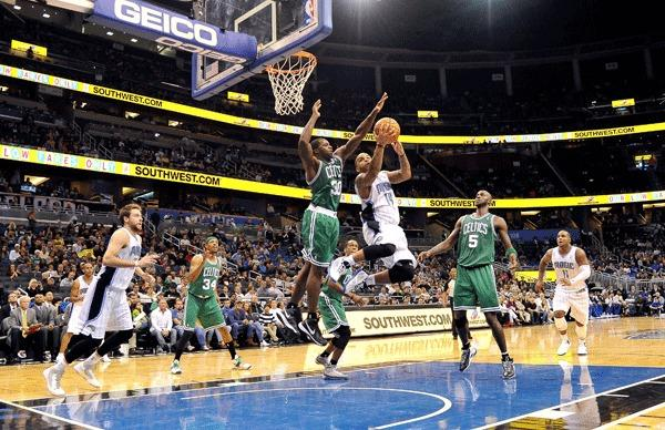 Orlando Magic point guard Jameer Nelson (14) shoots over Boston Celtics power forward Brandon Bass (30) at The Amway Center. Boston defeated Orlando 116 to 110 in overtime.