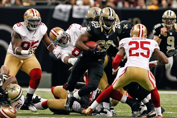 New Orleans Saints running back Chris Ivory (29) runs against the San Francisco 49ers during the second half of a game at the Mercedes-Benz Superdome. The 49ers defeated the Saints 31-21.