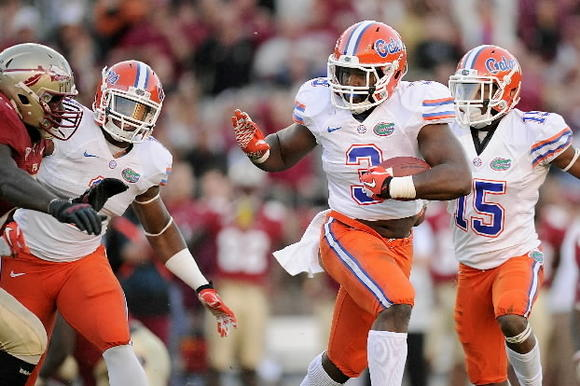 UF's Jelani Jenkins (3) runs back an interception at Florida State. Kevin Liles, US-Presswire.