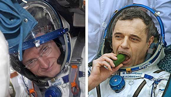 U.S. astronaut Scott Kelly, left, and Russian cosmonaut Mikhail Kornienko have been picked for a year-long trip to the International Space Station.