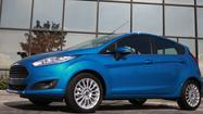 With every automaker competing to get more power from less fuel, Ford this week will unveil a three-cylinder that could portend a larger trend toward smaller engines.
