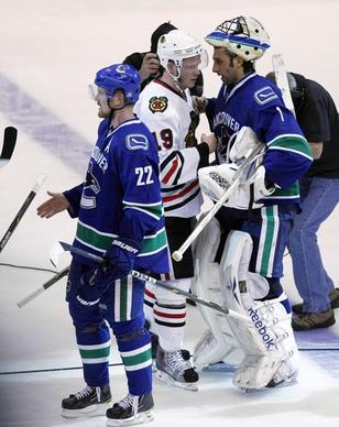 Chicago Blackhawks' Jonathan Toews shakes hands with Vancouver Canucks' Roberto Luongo after Canucks' 2-1 win in 1st overtime during Stanley Cup Playoffs' Round 1 Game 7 at Rogers Arena in Vancouver, British Columbia.