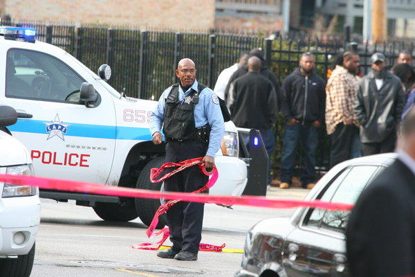 Chicago police investigate after two people were shot on the 300 block of East 71st Street on Monday morning. The shooting took place near the A.A. Rayner & Sons Funeral Home.
