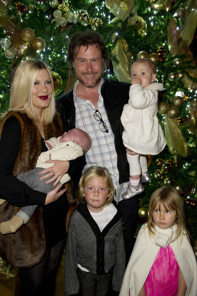Tori Spelling and her husband, Dean McDermott, and their family, light the tree at The St. Regis Monarch Beach Resort's 12th annual Holiday Tree Lighting Ceremony on Sunday  in Dana Point.  Liam, 5, left, and Stella, 4, stand with the family, along with Hattie, held by McDermott, and Finn, 3 months.