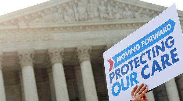 Demonstrators protest the Affordable Care Act outside the U.S. Supreme Court in June. The high court has permitted a group to argue two claims against the healthcare law in a lower court.