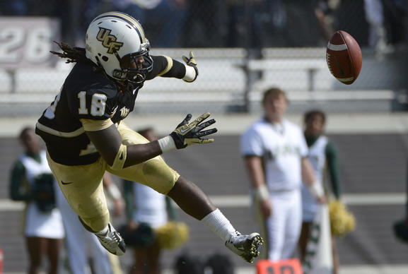UCF's Mark Rucker (16) swats the ball back in play after diving into the end zone after a punt during the first half of an NCAA college football game against UAB in Orlando, Fla., Saturday, Nov. 24, 2012. The ball was downed on the one-yard-line.(