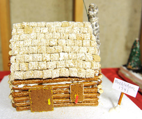 "Ken and Moria Turner and Doris Hess's gingerbread house, ""Original Bethlehem Cabin 1741,"" on Friday.  Ken and Moria Turner's family comes from many places for Thanksgiving and the family's annual gingerbread house competition."