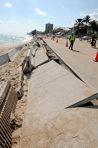 Barricades fill the beach alongside crumbling sidewalks and seawall along A1A just north of Sunrise Blvd.