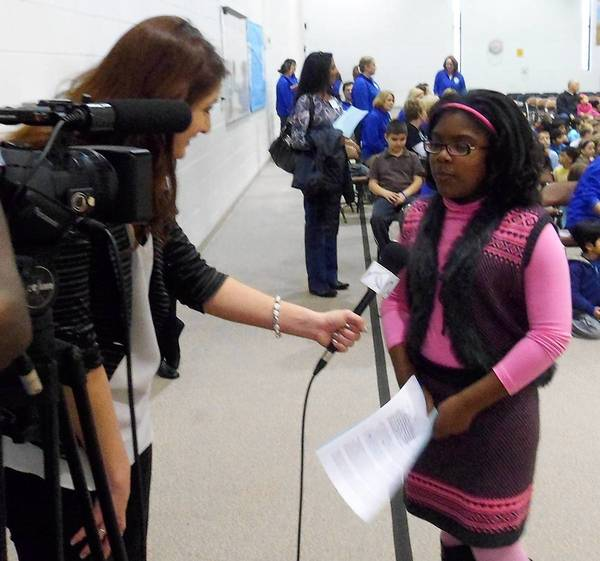Fry Elementary School fifth grader Morgan Jones is interviewed for television about her speech prior to a school assembly.