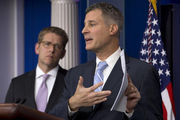 White House Council of Economic Advisors Chairman Alan Krueger, right, accompanied by White House Press Secretary Jay Carney, speaks to reporters about taxes, spending and the fiscal cliff.