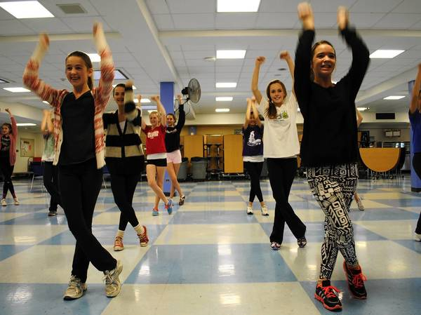 "The Wilmette Junior High School dance team practices a routine set to an instrumental version of LMFAO's ""Party Rock Anthem."""