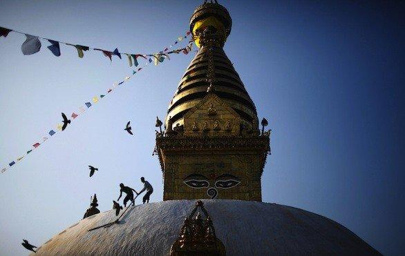 The Swayambhunath stupa or temple on a hill in Kathmandu receives a touch-up. It's one of the stops on a volunteer trip organized by United Planet.