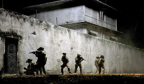 "Navy SEALs raid Osama bin Laden's compound in a scene from ""Zero Dark Thirty."""