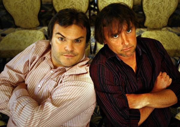 "Jack Black, left, and writer–director Richard Linklater horse around before they talk about their collaboration on ""Bernie."""