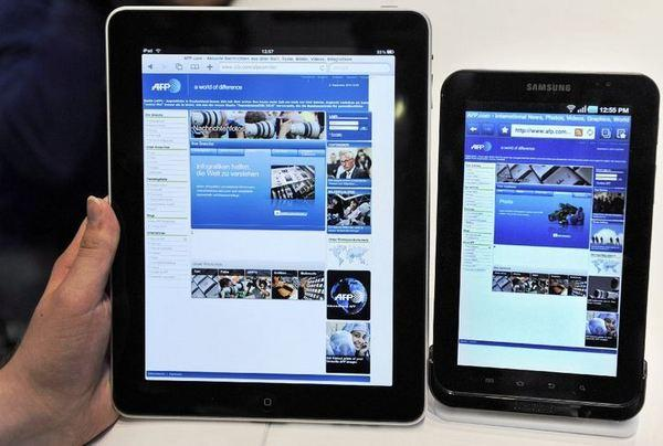 On the left, an Apple iPad from 2010. On the right, Samsung's Galaxy tablet.