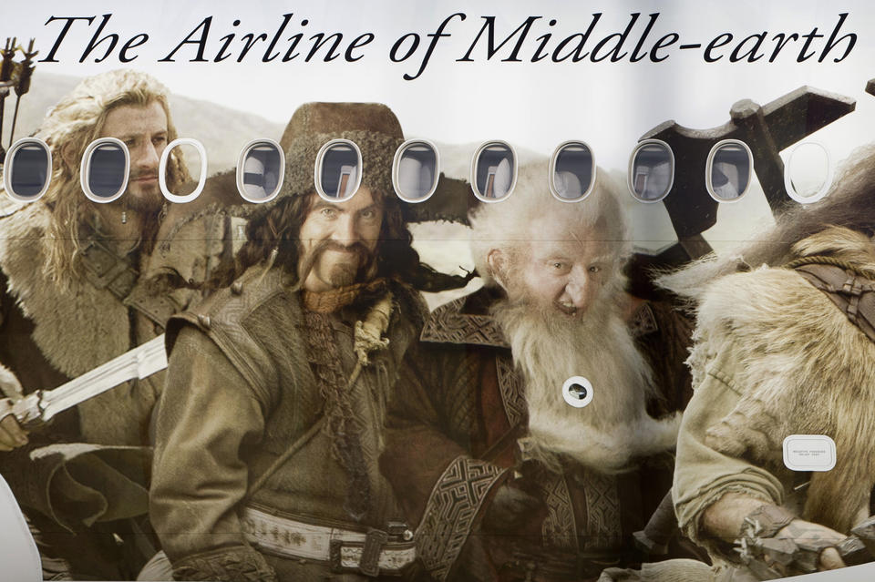 An Air New Zealand's Boeing 777-300ER featuring livery advertising the film The Hobbit: An Unexpected Journey lands at Heathrow Airport in London.