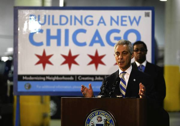 Mayor Rahm Emanuel touts water and sewer line upgrades, as well as street repaving, during a news conference Monday. The mayor also said proposed rate increases for CTA passes were not actually fare increases, noting that the base fare of $2.25 per ride would remain unchanged.