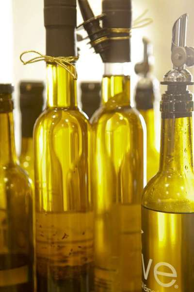 One of the stores in the OC Mart MIX is We Olive & Wine Bar, a wine and olive-oil tasting spot with many different types of olive oils and wines for tasting and purchase at the South Coast Collection in Costa Mesa.