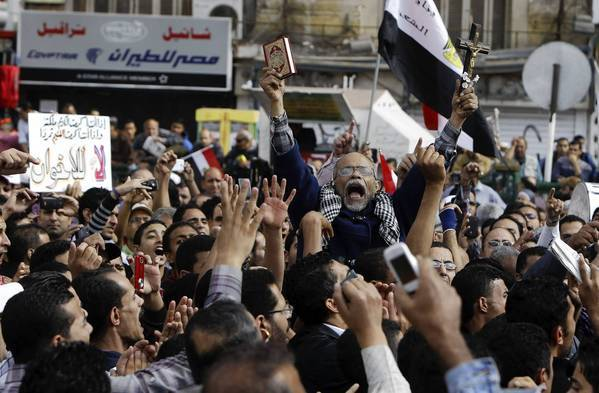 Protesters chant slogans against Egyptian President Mohammed Morsi during a recent rally at Cairo's Tahrir Square. Morsi's edict making his decisions immune from judicial review triggered widespread public anger.