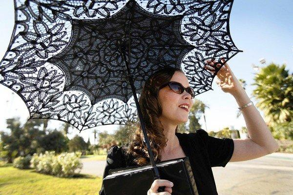 Karie Bible, in her 1940s-style dress, retro sunglasses and lacy black parasol, leads a tour at Hollywood Forever Cemetery. Unlike the usual rumor-laden Hollywood death tour, there's not an ounce of fiction as she tells visitors about the famous and nearly forgotten.