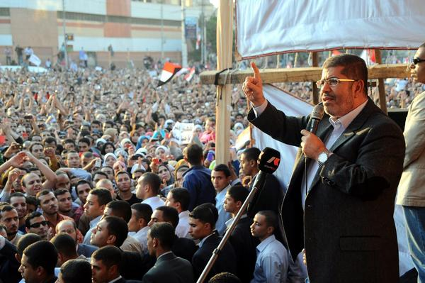 Egyptian President Mohamed Morsi delivers a speech to supporters next to the Presidential Palace in Cairo.