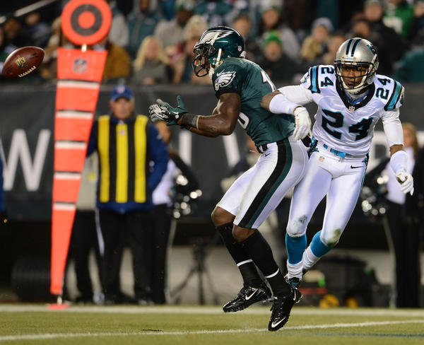 Philadelphia Eagles wide receiver Jeremy Maclin (18) looks to catch a pass as Carolina Panthers cornerback Josh Norman (24) gets pushed away at Lincoln Financial Field in Philadelphia on Monday.