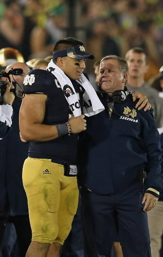 Notre Dame star linebacker Manti Te'o embraces coach Brian Kelly. Jonathan Daniel, Getty Images.