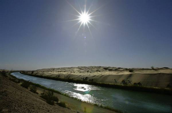 The All-American Canal flows past the Algodones Dunes in southeastern California. A proposal by the U.S. government to use the canal to deliver water to Mexico doesn't sit well with farmers and officials in the Imperial Valley.