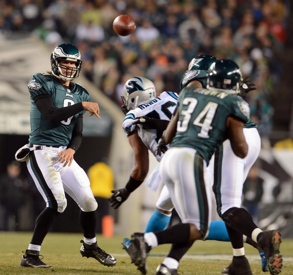 Philadelphia Eagles quarterback Nick Foles (9) passes to Philadelphia Eagles running back Bryce Brown (34) in their game against the Carolina Panthers at Lincoln Financial Field in Philadelphia on Monday.