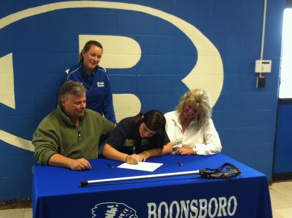 Boonsboro senior Alex Green, seated center, recently signed a letter of intent to play lacrosse at Shepherd University. She is joined by her parents, Randy and Donna Green, seated left and right, and by Boonsboro girls lacrosse coach Susan Funke, standing.