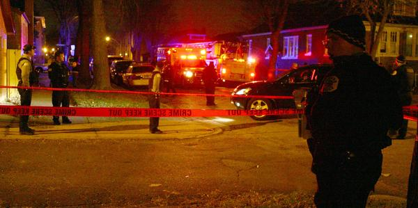 Chicago police investigate the shooting of a 15-year-old-girl at 70th Street and Campbell Avenue on the South Side.