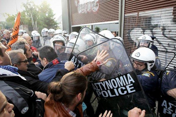 Protesting municipal workers clash with riot police in the port city of Thessaloniki, Greece, earlier this month.
