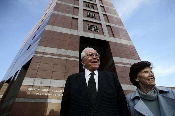 "Robert Schuller, left, and his wife, Arvella, leave bankruptcy court in downtown Los Angeles. Schuller — the founder of Crystal Cathedral and the face of the globally watched ""Hour of Power"" TV program — and his family will be paid just a fraction of the millions they sought from the preacher's bankrupt ministry."